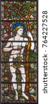 Small photo of LONDON, GREAT BRITAIN - SEPTEMBER 19, 2017: The forefather Adam on the stained glass in St Mary Abbot's church on Kensington High Street.