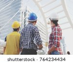 civil engineers looking and... | Shutterstock . vector #764234434