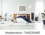 carpet and wooden bench near...   Shutterstock . vector #764235640