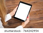 woman holding tablet on wooden... | Shutterstock . vector #764242954