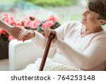 smiling old woman holding hands ... | Shutterstock . vector #764253148