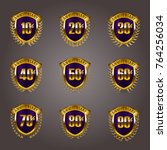 set of gold anniversary badges... | Shutterstock .eps vector #764256034