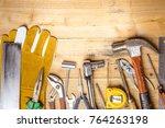 assorted work tools on wooden... | Shutterstock . vector #764263198