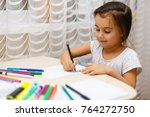 cute little girl doing homework ... | Shutterstock . vector #764272750