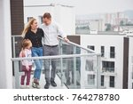 the young family chooses new... | Shutterstock . vector #764278780