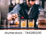 close up of bartender hands... | Shutterstock . vector #764280100