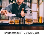 close up of barman hands adding ... | Shutterstock . vector #764280106