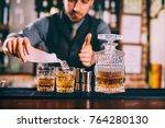 portrait of bartender adding... | Shutterstock . vector #764280130