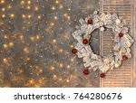 christmas snow covered wreath... | Shutterstock . vector #764280676