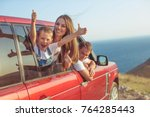 the family travels by car | Shutterstock . vector #764285443