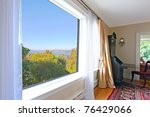 Large window in an old house with a view of the Tacoma old town in the summer. - stock photo