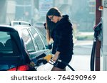 beautiful girl poured fuel into ... | Shutterstock . vector #764290969