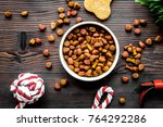 Stock photo dry dog food in bowl on wooden background top view 764292286