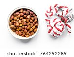 dry dog food in bowl on white... | Shutterstock . vector #764292289