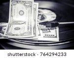 vinyl record and money | Shutterstock . vector #764294233