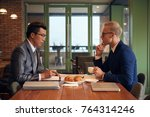 business partners drinking... | Shutterstock . vector #764314246