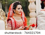 indian groom dressed in white... | Shutterstock . vector #764321704