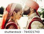 indian groom dressed in white...   Shutterstock . vector #764321743