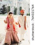 indian groom dressed in white... | Shutterstock . vector #764321764