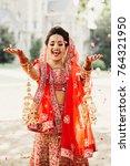 stunning indian bride dressed... | Shutterstock . vector #764321950
