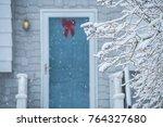 a cozy door and porch of a... | Shutterstock . vector #764327680