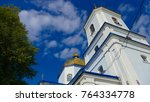 Small photo of Orthodox church in the city of Bar. Prodigal silhouette of an orthodox church against the blue sky. Clouds moving in the background.