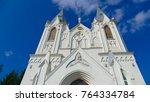 Small photo of Catholic Church in Bar. Prodigal silhouette of a Catholic church against a blue sky. Clouds moving in the background.