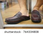man wears a classic leather... | Shutterstock . vector #764334808