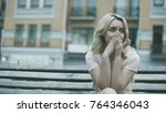 sad young lady sitting alone... | Shutterstock . vector #764346043