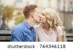 sweet kiss of beautiful young... | Shutterstock . vector #764346118