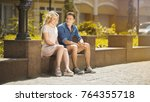 male and female sitting on... | Shutterstock . vector #764355718