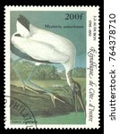 Small photo of Cote d'Ivoire - stamp printed in1985, Series Audubon birds bicentenary, Air Mail issue, Birds, Wood Stork