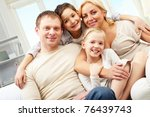 a family of four embracing and... | Shutterstock . vector #76439743