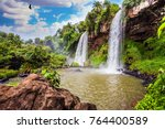 two fairy powerful waterfalls... | Shutterstock . vector #764400589