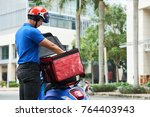 delivery man taking food out of ... | Shutterstock . vector #764403943