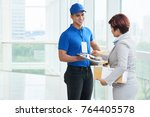 business woman receving package ... | Shutterstock . vector #764405578