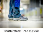 safety boots and trousers of a... | Shutterstock . vector #764411950