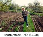 a woman in jeans  a sweatshirt... | Shutterstock . vector #764418238