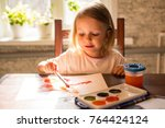 a little girl of three years is ...   Shutterstock . vector #764424124