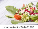 salad with pomegranate close up | Shutterstock . vector #764431738