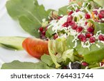 salad with pomegranate close up | Shutterstock . vector #764431744