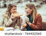 portrait of two young women... | Shutterstock . vector #764432560