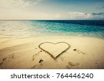 heart shape drawn on a sand at... | Shutterstock . vector #764446240