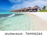 water villas in a row by the... | Shutterstock . vector #764446264