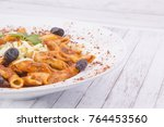 penne with cheese and tomato... | Shutterstock . vector #764453560