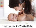 mom and baby boy in diaper... | Shutterstock . vector #764461084