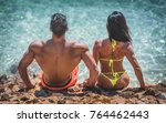 muscular man and woman sitting... | Shutterstock . vector #764462443