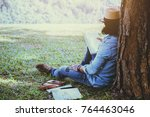 asian man relax in the holiday. ...   Shutterstock . vector #764463046