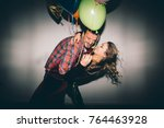 young couple having fun at the... | Shutterstock . vector #764463928