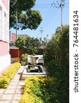 Small photo of CAPE TOWN, SOUTH AFRICA - CIRCA OCTOBER 2017: Front yard and garden of a Victoria villa in Sea Point, an affluent suburb of Cape Town